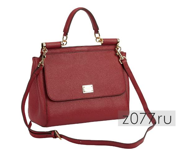 75e4e011aaac Сумка бордового цвета будет гармонично сочетаться с платьем и туфлями  такого же цвета. Тип застежки – магнитная кнопка. Материал – экокожа.